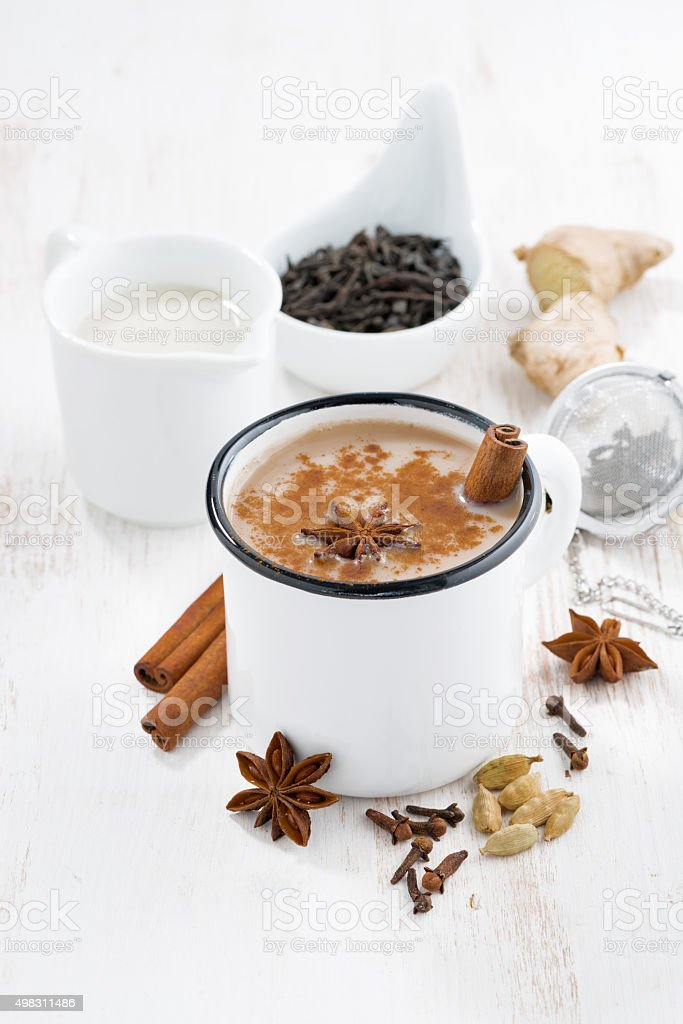 Masala tea and ingredients on white table stock photo