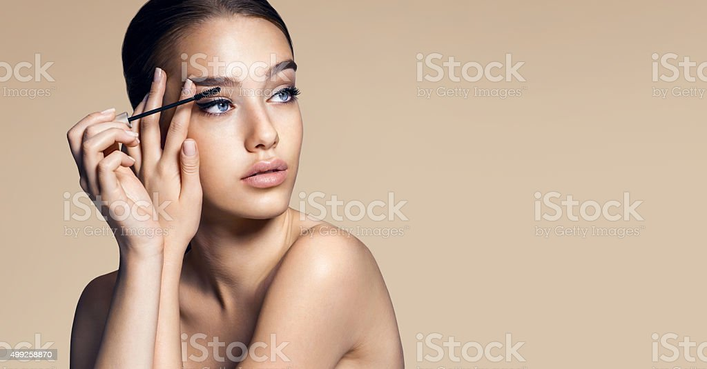 Mascara applying. Makeup closeup. Eyes make-up stock photo