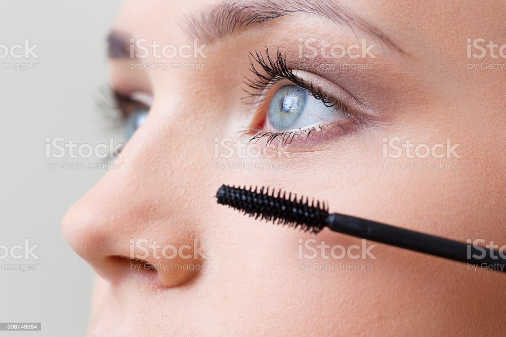 Mascara applying stock photo