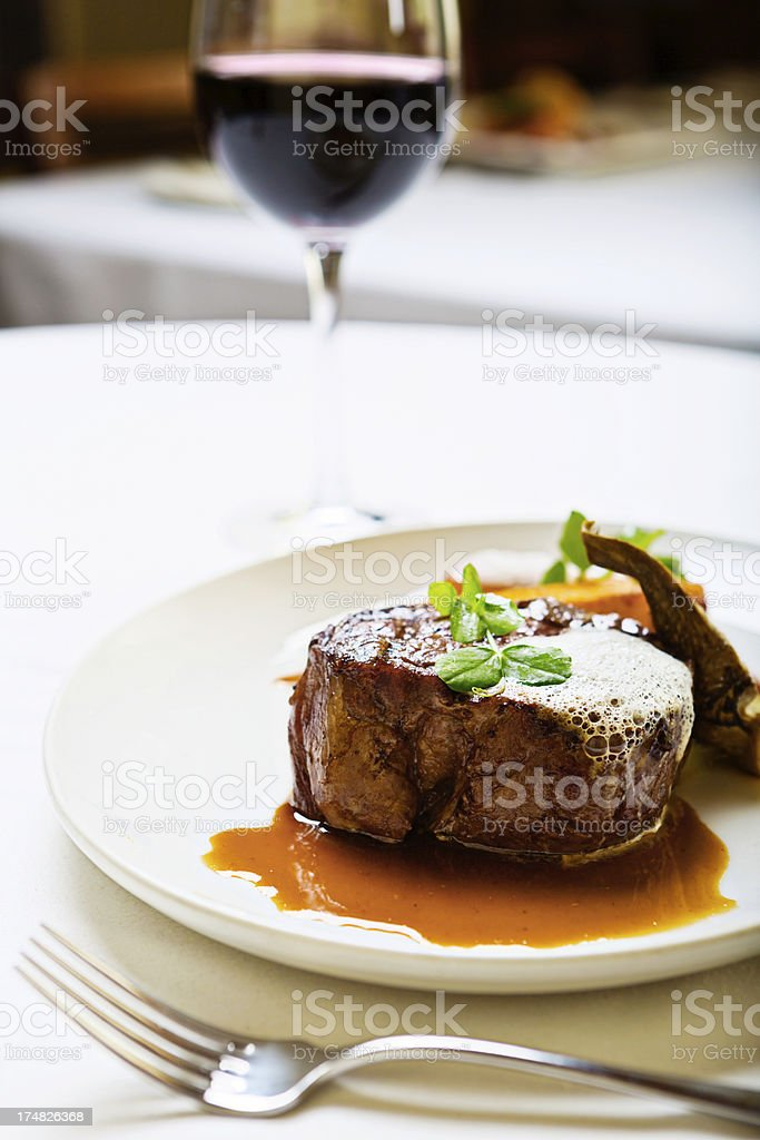 Masculine appeal in restaurant meal of steak and red wine stock photo