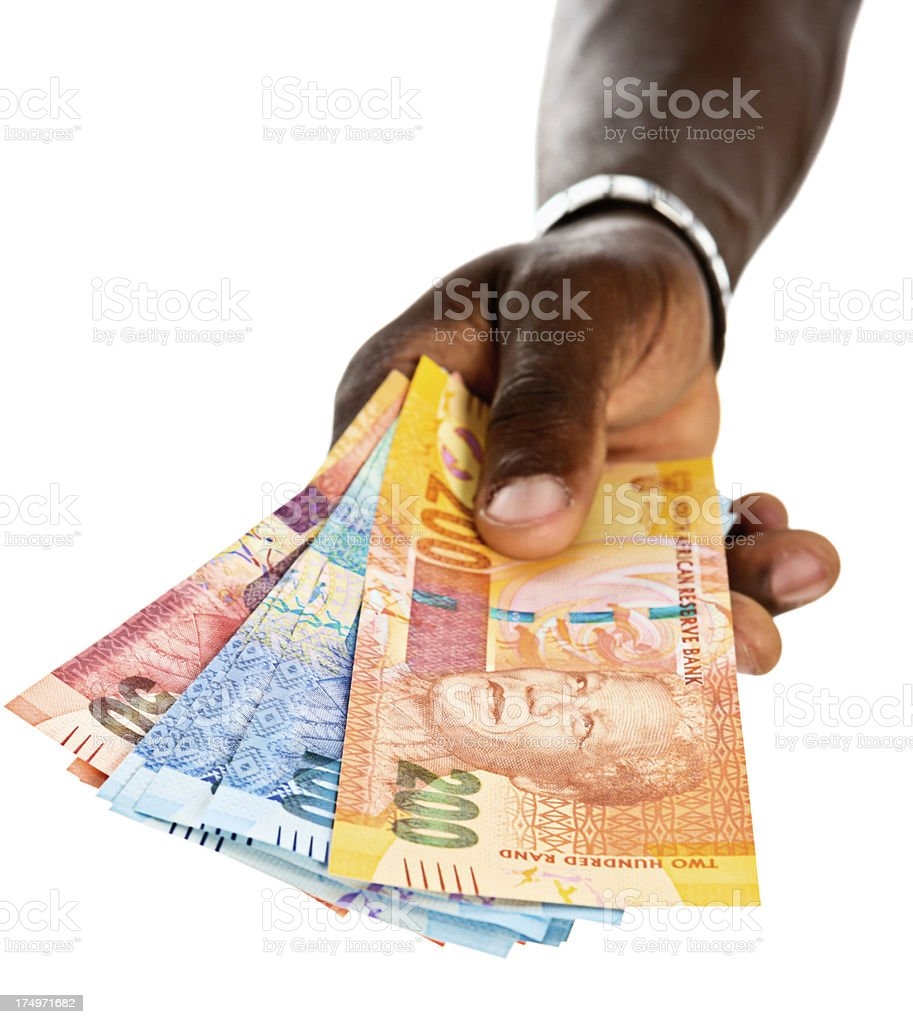 Masculine hands hold out sheaf of new South African banknotes royalty-free stock photo