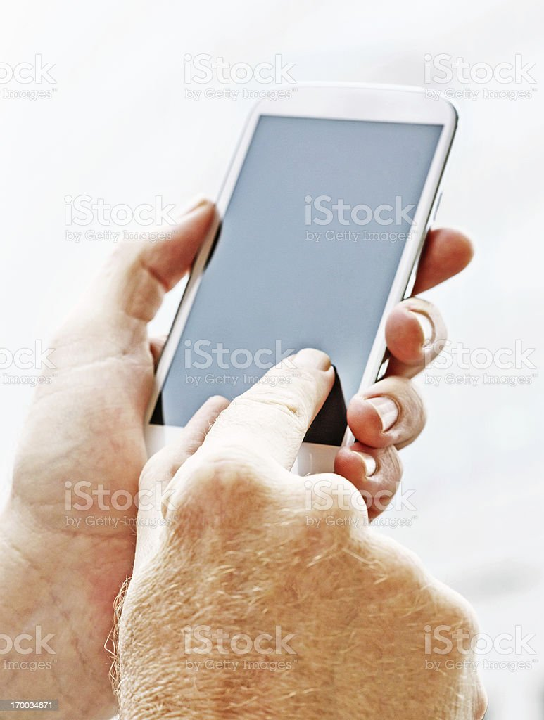 Masculine hands touching blank screen of smart phone royalty-free stock photo
