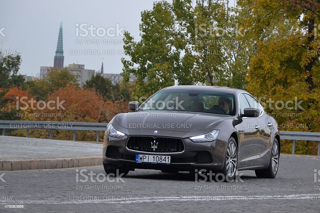Maserati Ghibli in motion on the street stock photo
