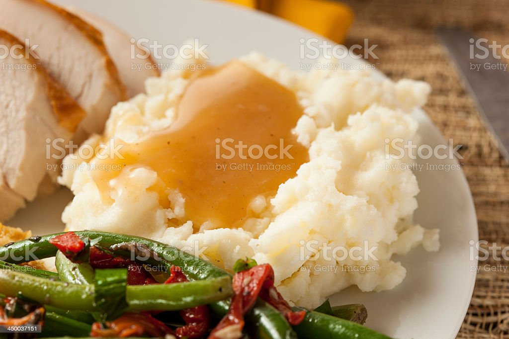 Mash potato and gravy with green beans and turkey slices stock photo