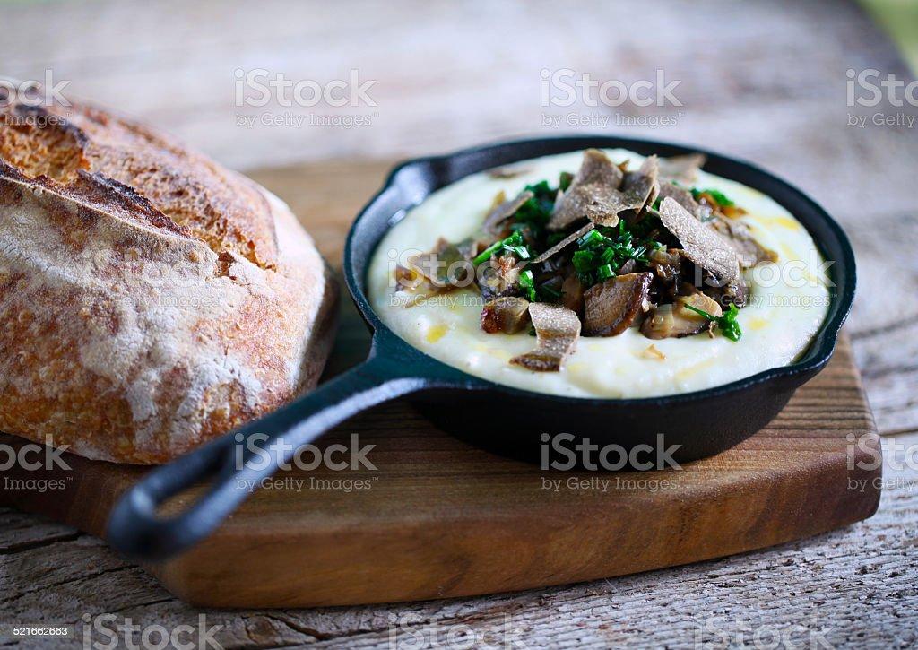Mashed potato and cheese fondue with black truffle and wild mushrooms stock photo