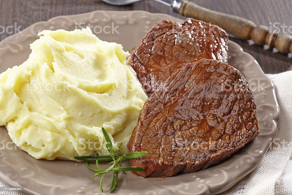 Mashed potatoes and beef steak royalty-free stock photo