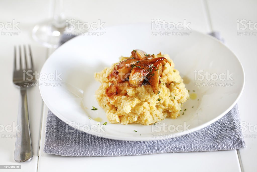 Mashed potatoes of rutabagas, sweet potato and caramelized pears stock photo