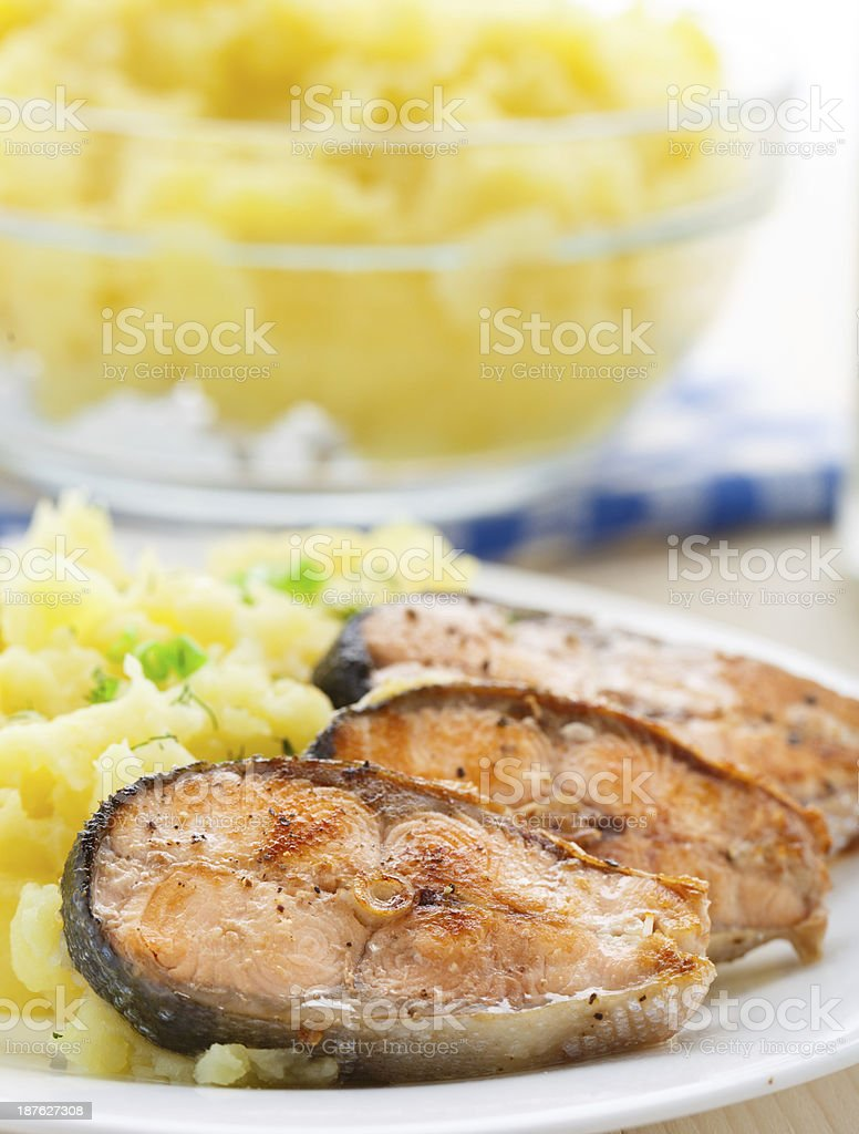 Mashed potatoes with fried salmon stock photo