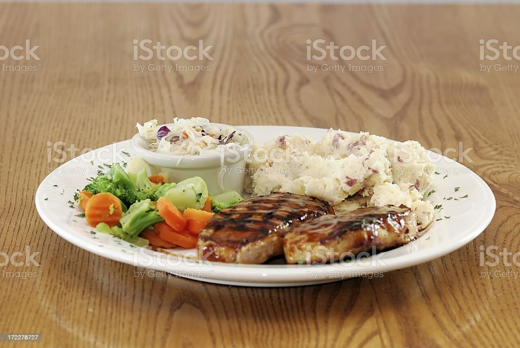 mashed potatos and pork chops royalty-free stock photo