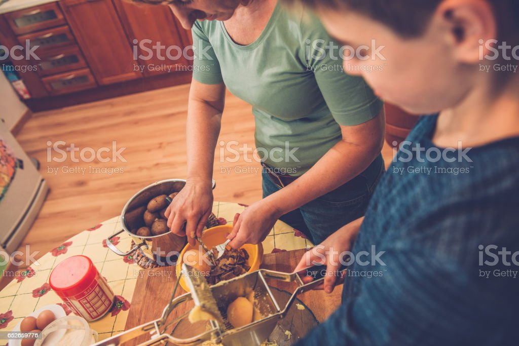 Mashing Potatoes for Gnocchi with Ricer, Southern Europe stock photo
