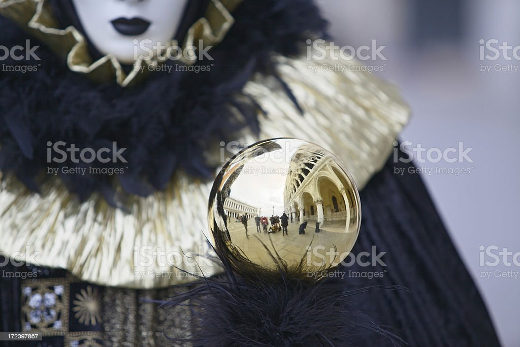 Mask at Venice Carnival with ball mirroring Doge's Palace colonnade. royalty-free stock photo