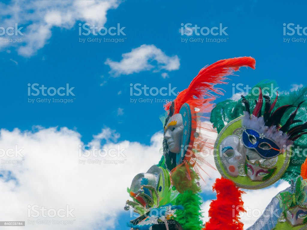 mask carnival parade costume with feathes low angle stock photo