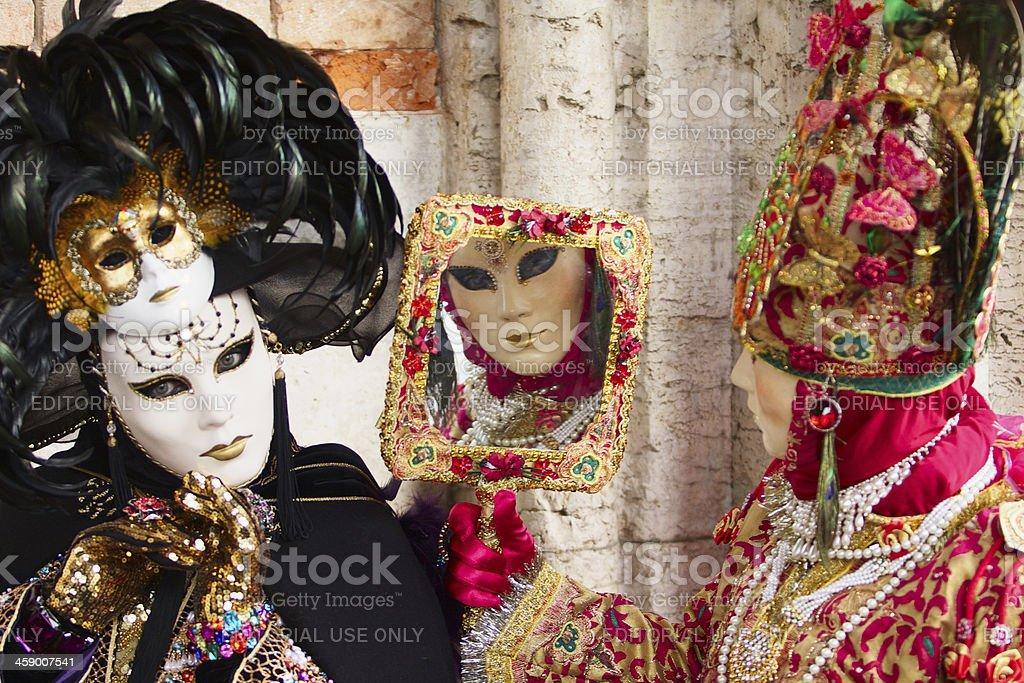 Mask mirroring at Venice Carnival 2013 royalty-free stock photo