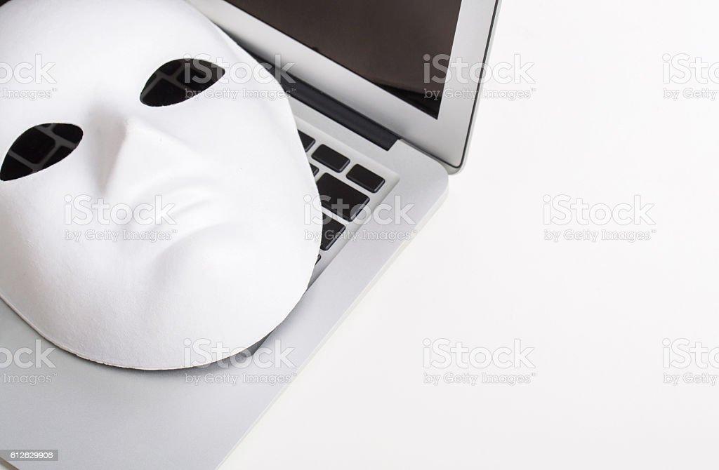 mask on laptop stock photo