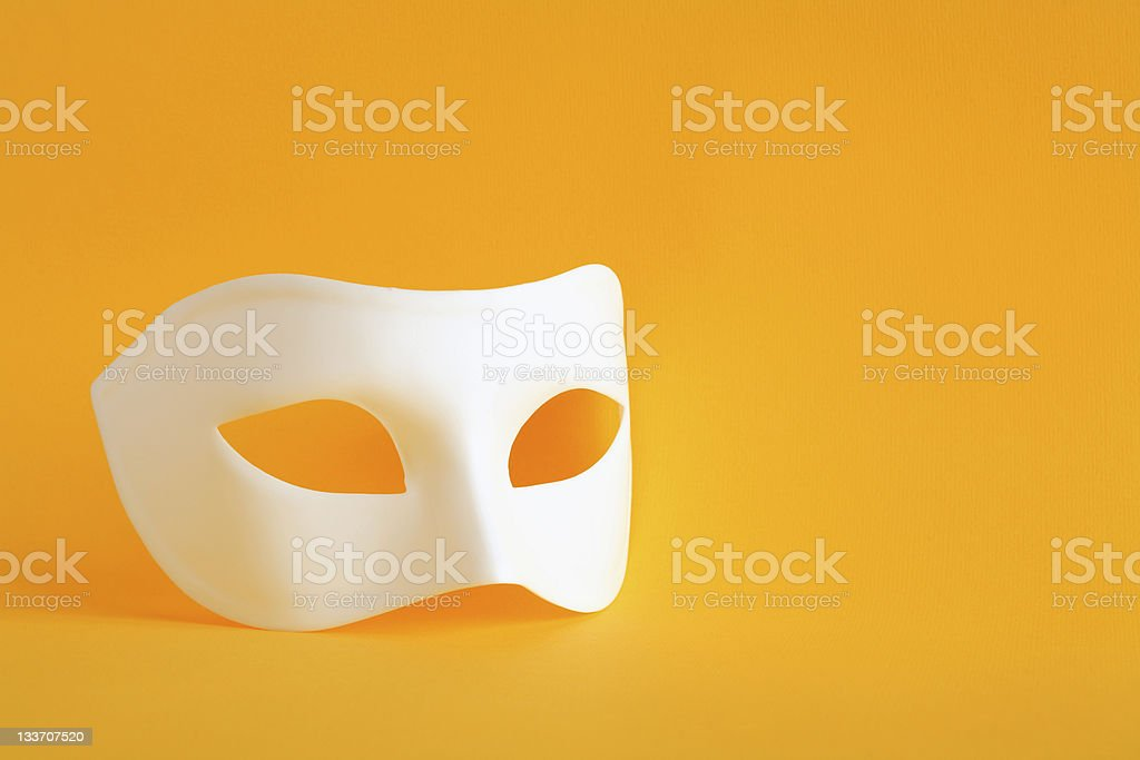Mask On Yellow stock photo
