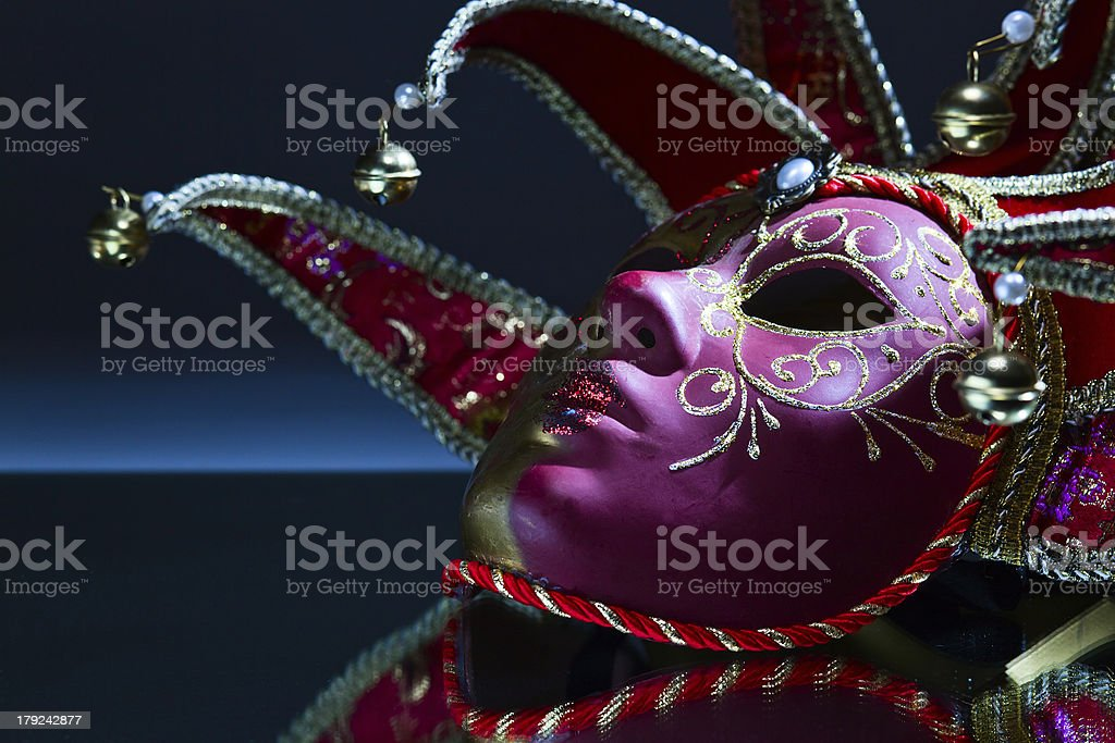 mask with bells on a mirror table royalty-free stock photo