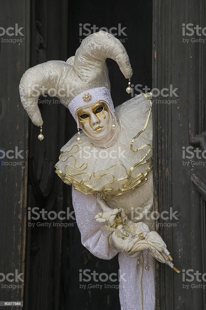 Mask with white Jester costume at carnival in Venice (XXL) stock photo