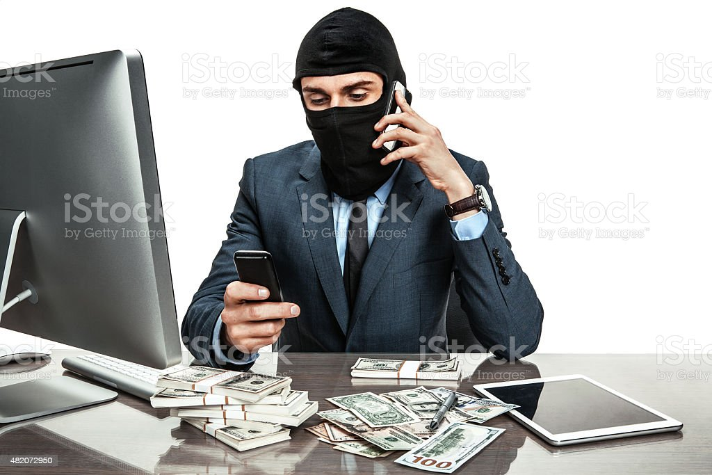 Masked anonymous businessman wearing balaclava helmet stock photo