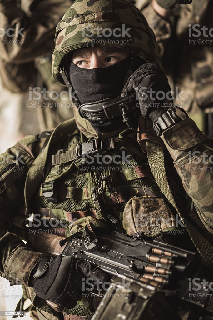Masked armed soldiers in battle stock photo