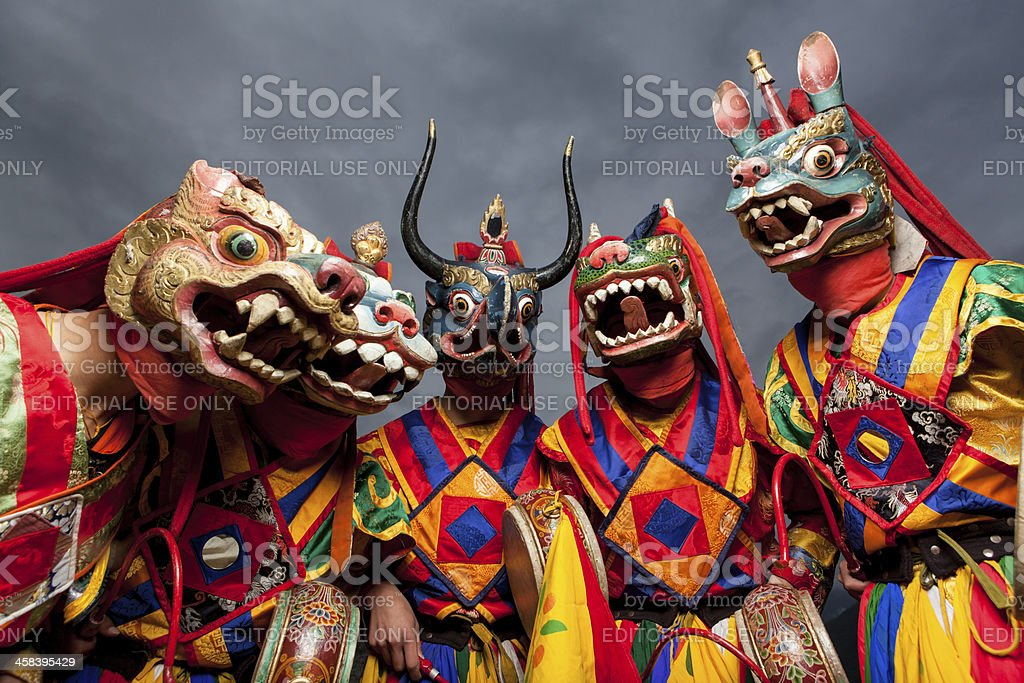 Masked bhutanese dancers in traditional costumes royalty-free stock photo