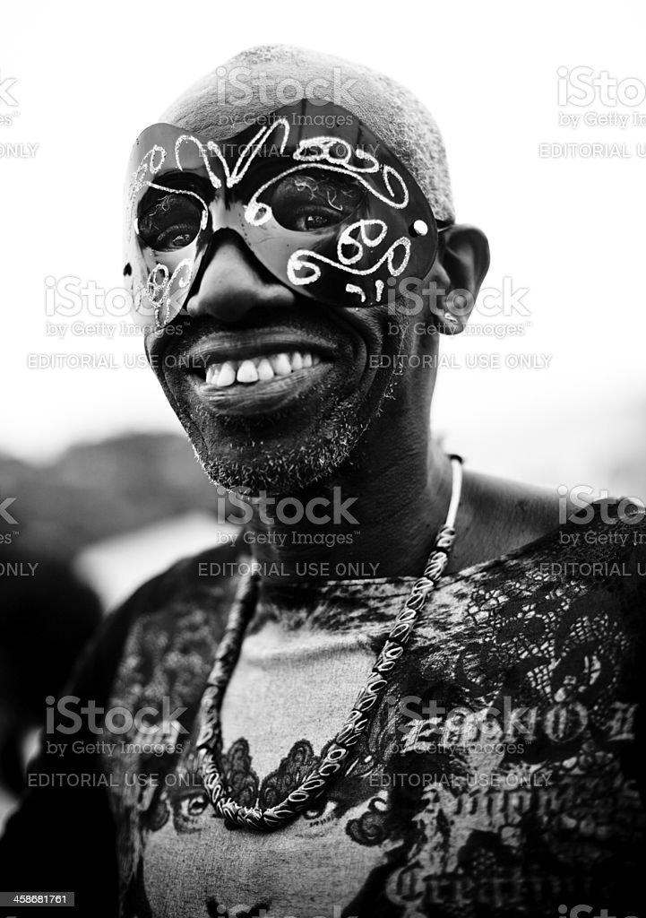 Masked Brazilian man celebrating Carnival royalty-free stock photo