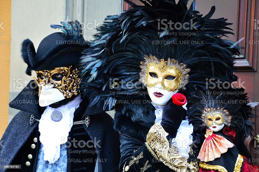 Masked couple in Renaissance costumes stock photo