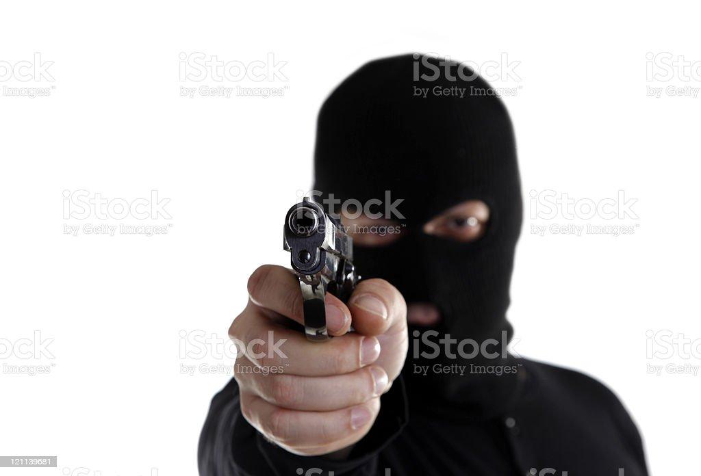 Masked man aims with gun royalty-free stock photo