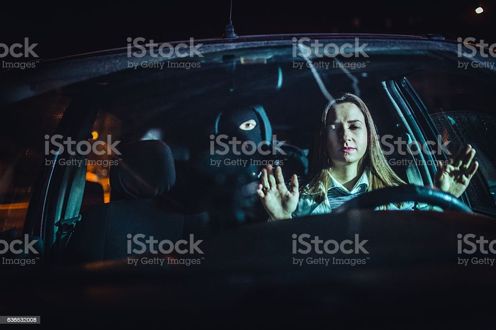 Masked man in the car stock photo