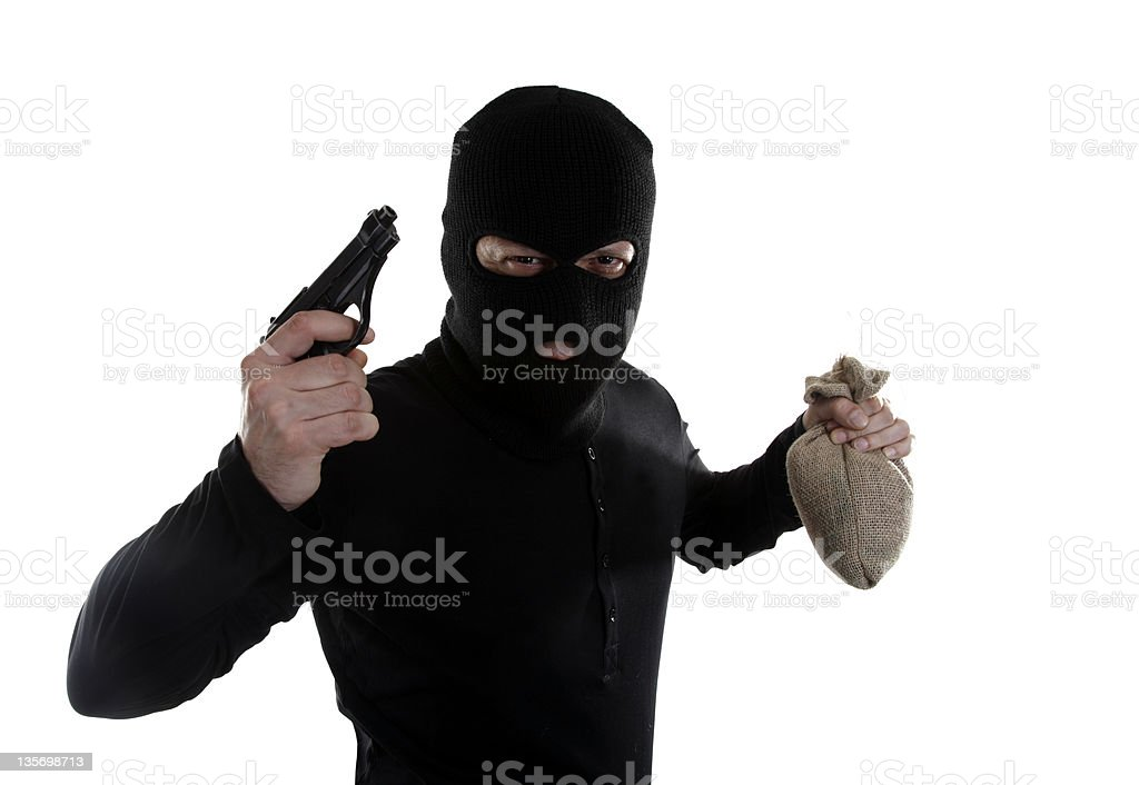 Masked man robber with gun and money bag royalty-free stock photo