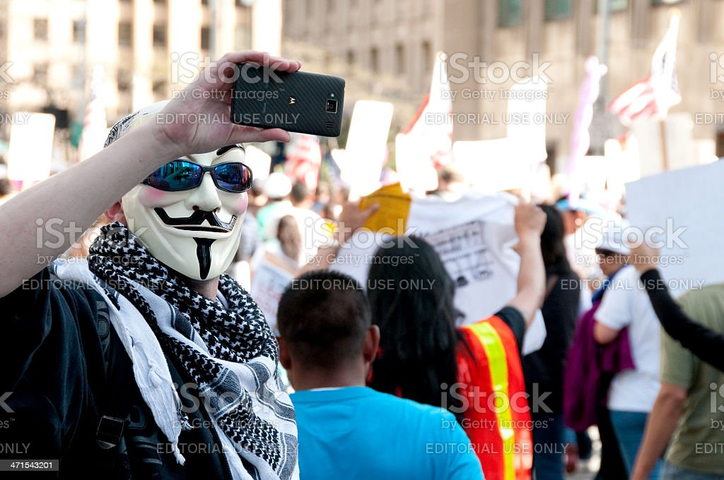 Masked Mayday Protestor royalty-free stock photo