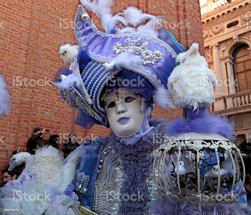 masked person on San Marco Square, Venice stock photo