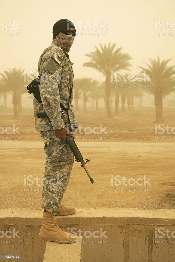 masked soldier in sandstorm stock photo