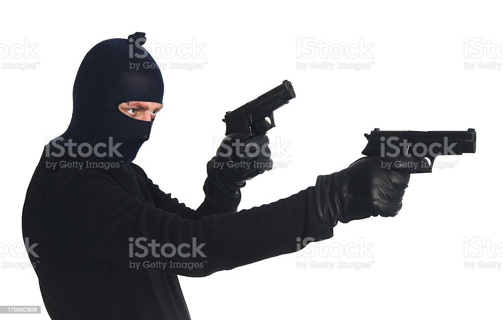Masked terrorist with two guns - isolated on white royalty-free stock photo
