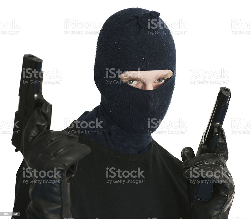 Masked terrorist with two guns royalty-free stock photo