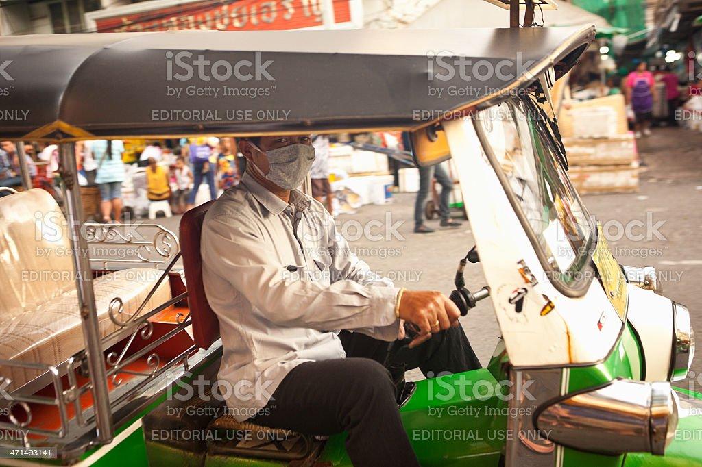 Masked TukTuk Driver royalty-free stock photo