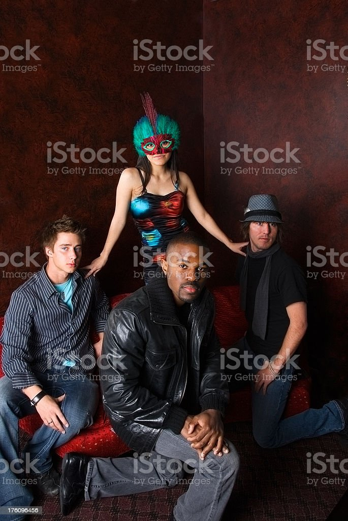 Masked woman and her entourage stock photo