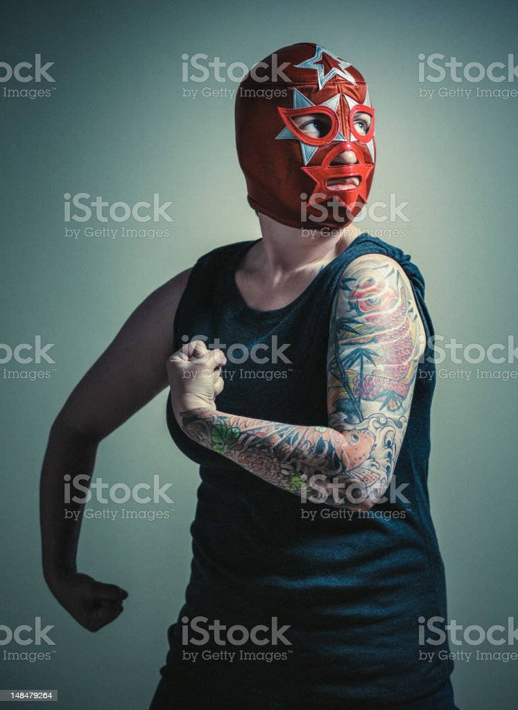 masked woman with tattoos stock photo
