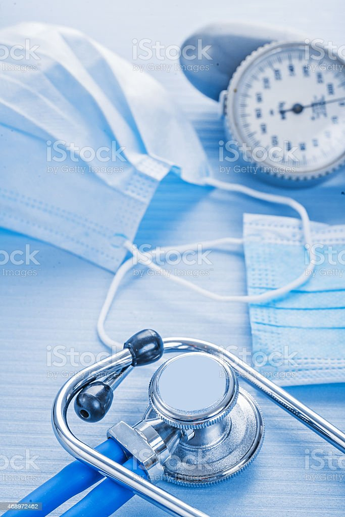 masks stethoscope blood pressure monitor on blue background medi stock photo