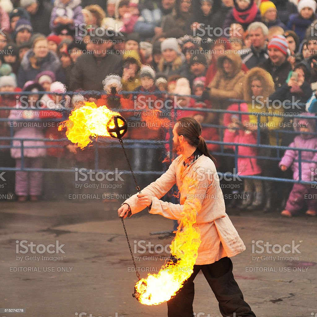 Maslenitsa, Pancake festival. Fire dancer man in Russian clothes stock photo