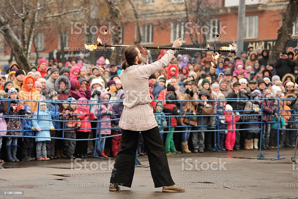 Maslenitsa, Pancake festival. Fire dancer man in Russian clothes performing stock photo