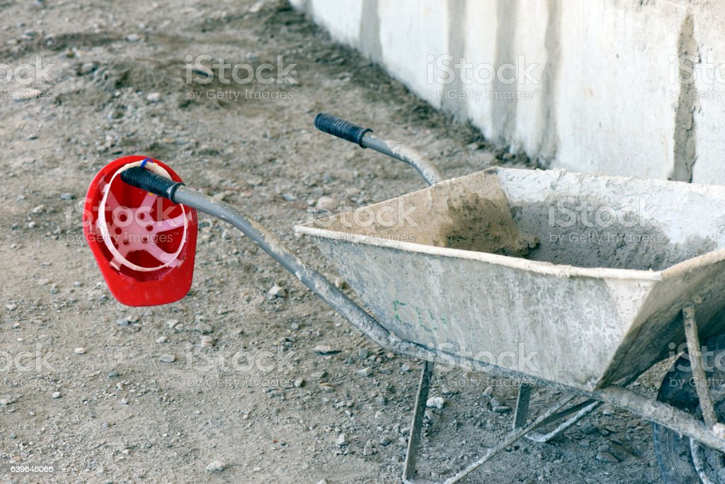 Mason cart leaning against the wall under construction stock photo