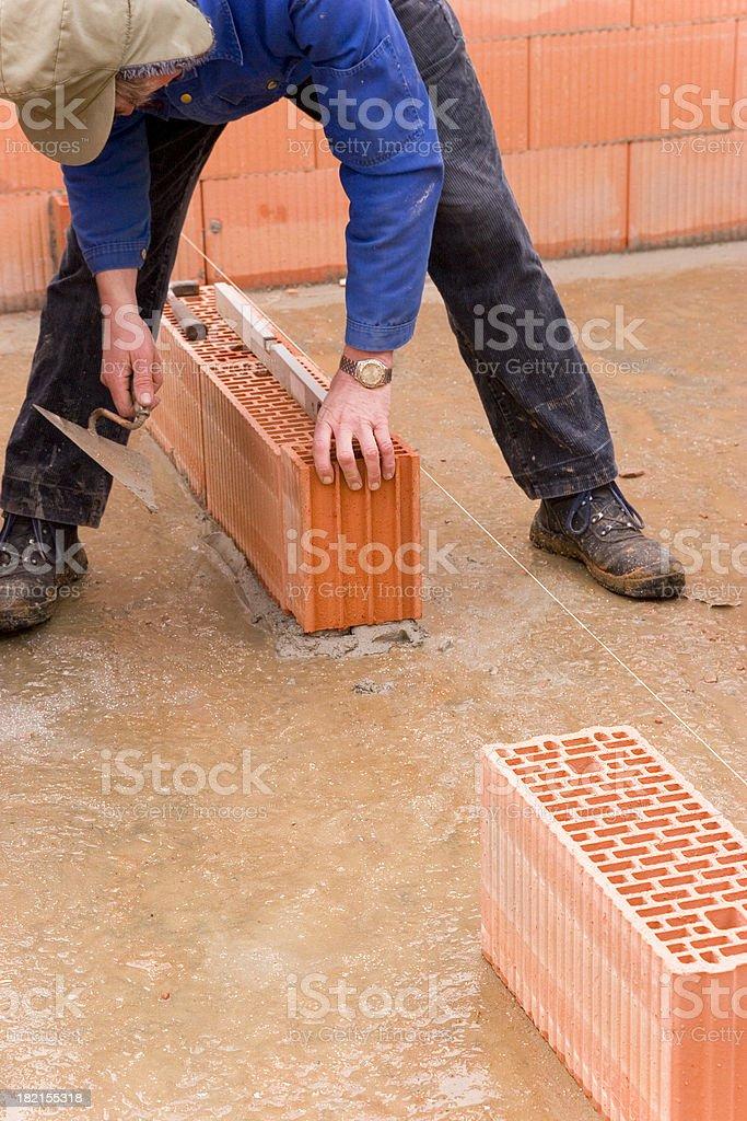 Mason Installing Wall royalty-free stock photo