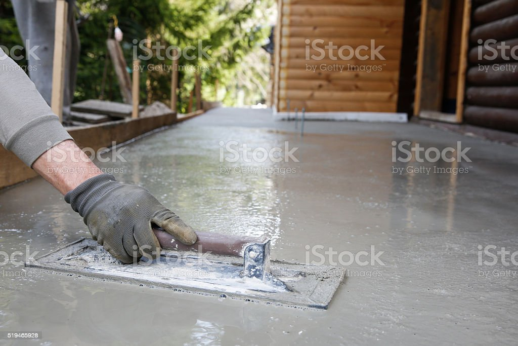 Mason leveling and screeding concrete floor base stock photo
