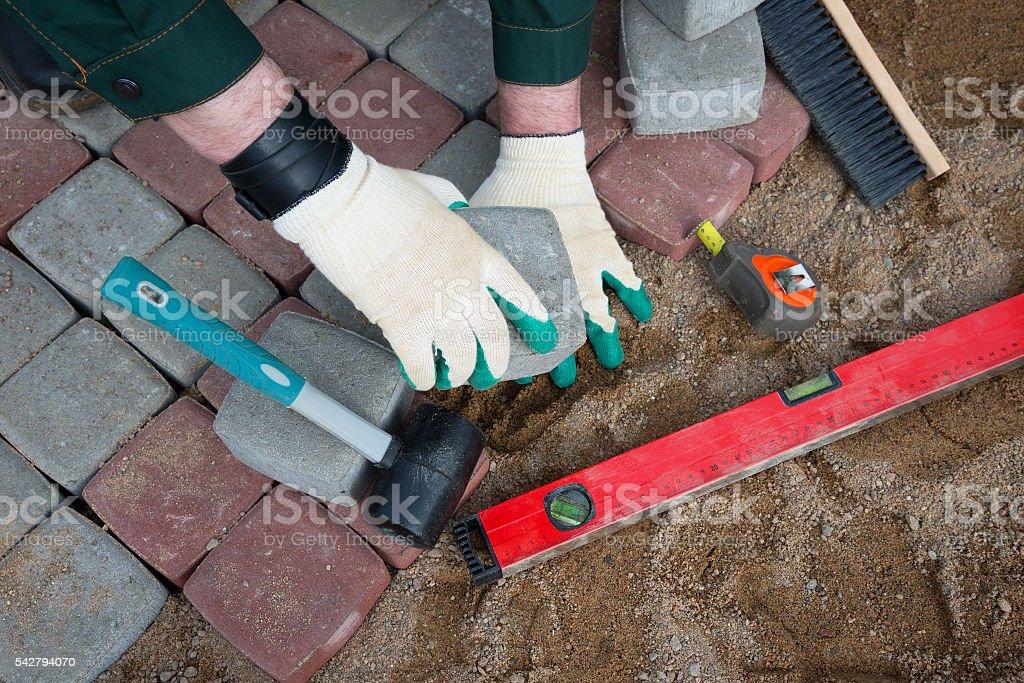 mason worker making sidewalk pavement stock photo