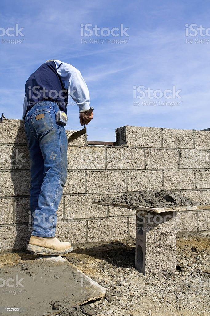 Mason working on wall stock photo
