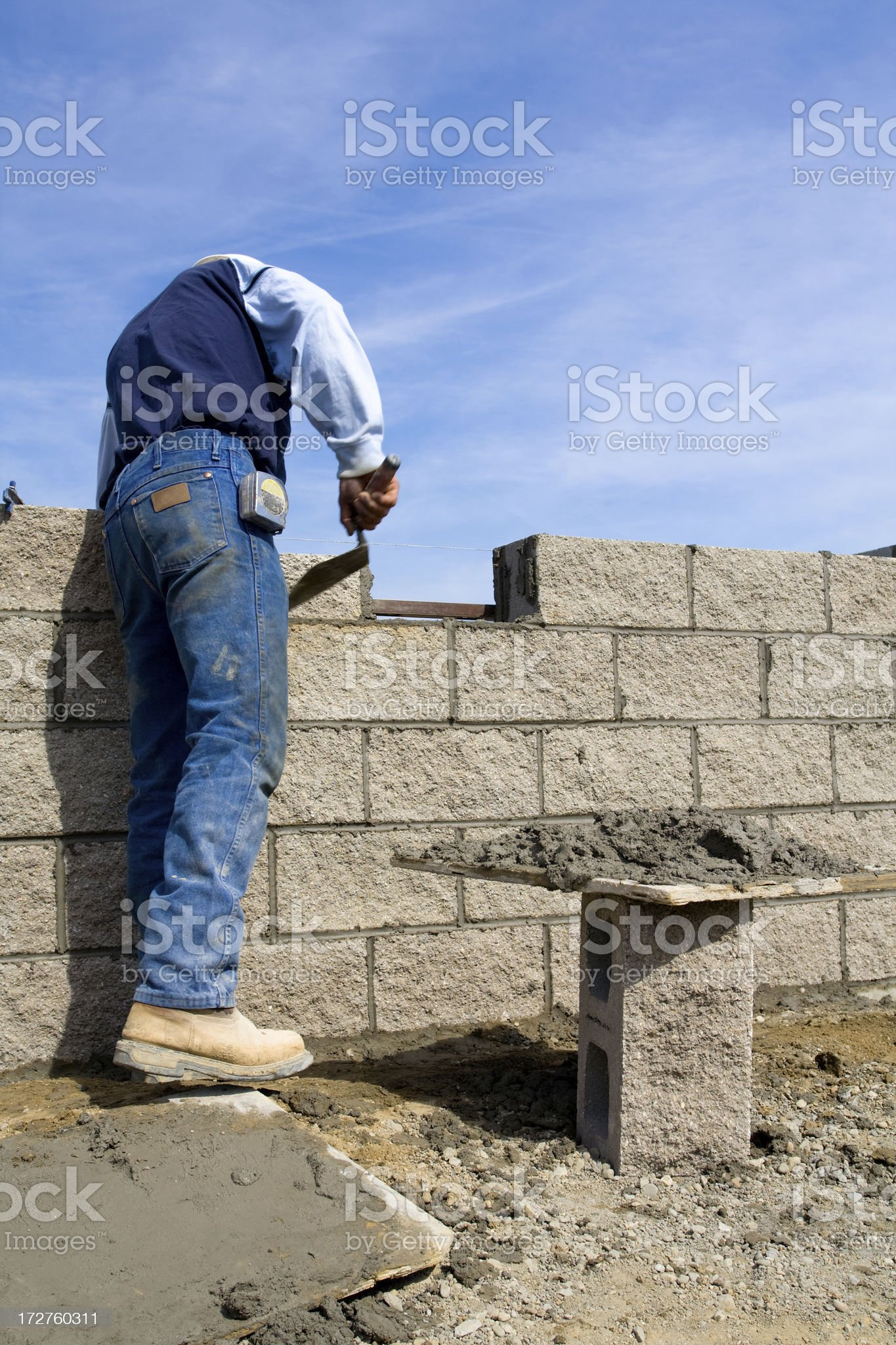Mason working on wall royalty-free stock photo