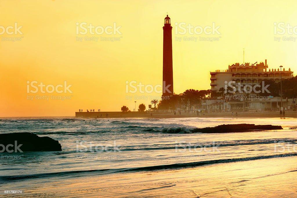 Maspalomas beach and lighthouse at sunset.  Gran Canaria, Spain stock photo