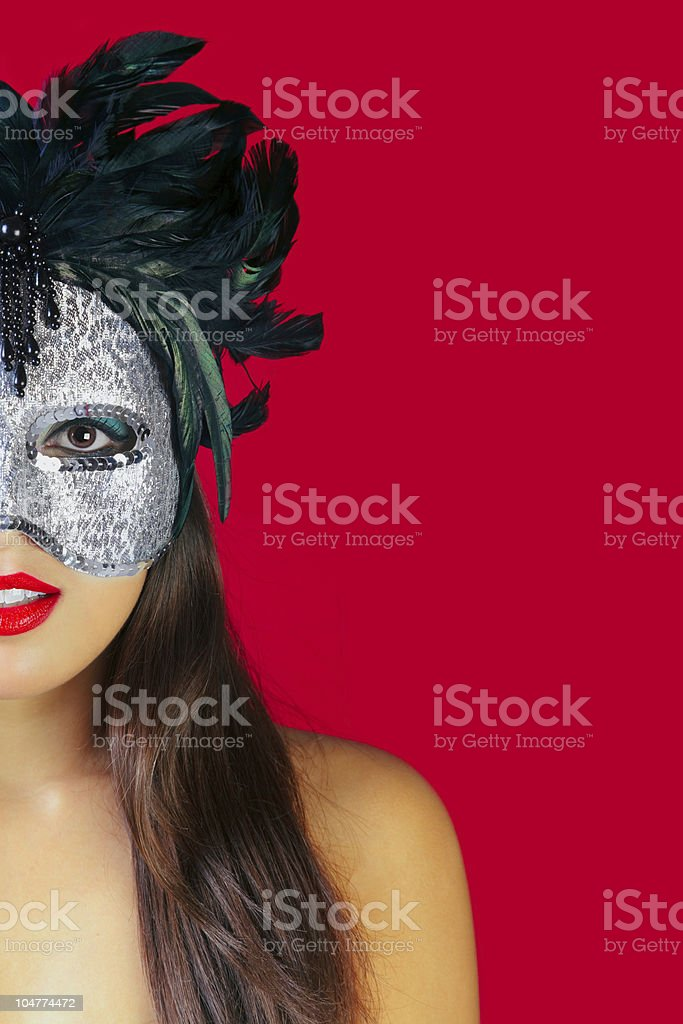 Masquerade mask red background stock photo