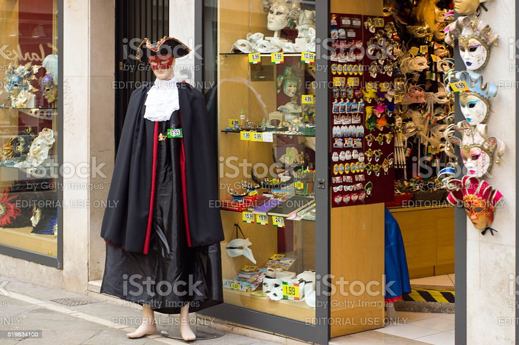 Masquerade mask shop with mannequin outside stock photo