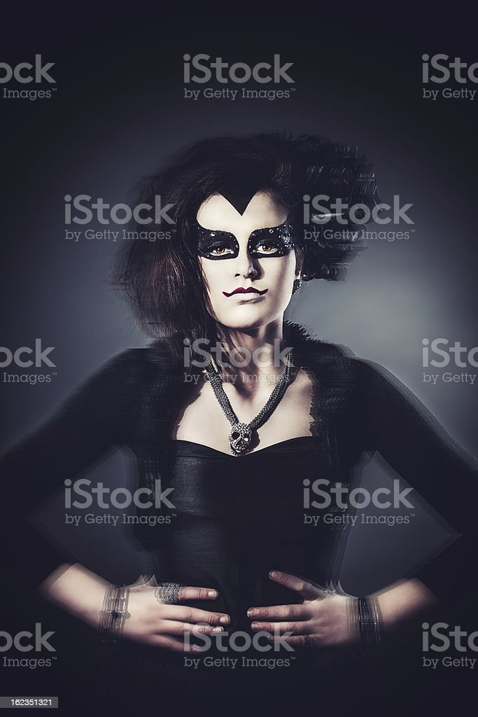 masquerade time girl dressed up as evil stock photo